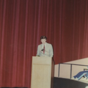 Man at podium at event