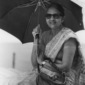 Woman in sari with umbrella