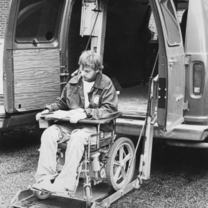 Martin Perry on lift for wheelchair accessible van