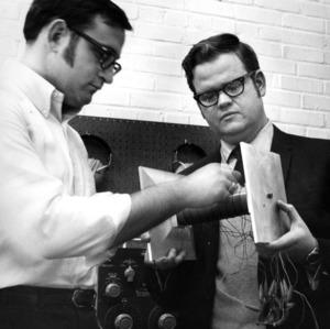 Men with laboratory equipment