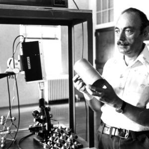 Professor with scientific equipment