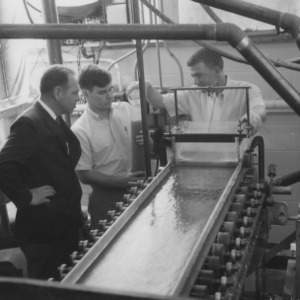 Three men with research machinery
