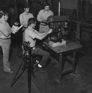 Men at precision engineering workshop