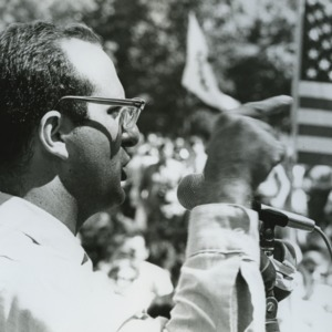 Man speaking at peace demonstration
