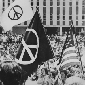 Peace sign flags and American flag at peace demonstration