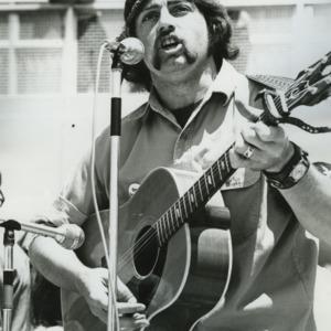 Man playing guitar at demonstration