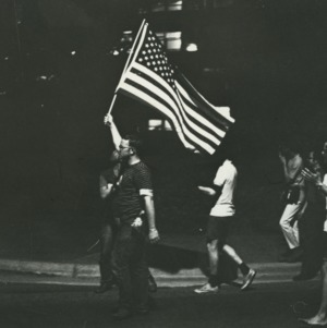 Students with American flag at march