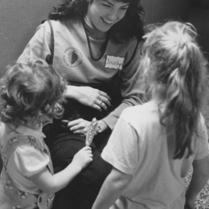 Jocelyn Carter and children with black rabbit at N. C. State Museum of Natural Sciences