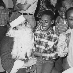 Man dressed as Santa at Christmas party for blind children