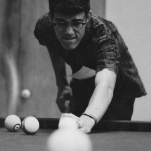 Student playing pool at Erdahl-Cloyd Student Union