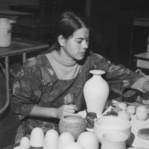 Student with pottery