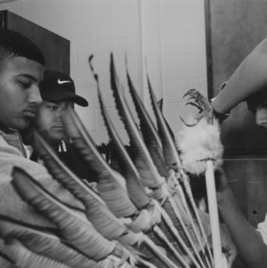 High school students preparing outfit for Native American Powwow