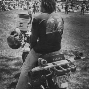 Man on motorcycle at outdoor event