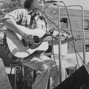 Guitarist on stage at oudoor concert
