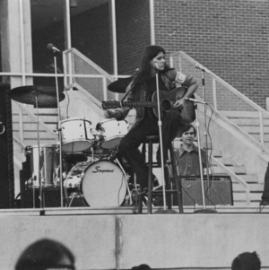 Band performing on stage at outdoor concert