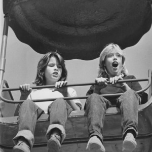 Children in ferris wheel car