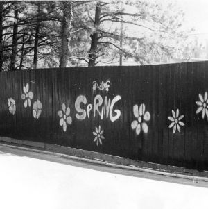 """Spring"" and flowers painting on fence"