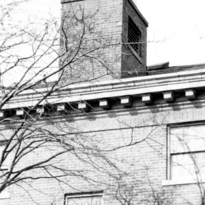 """Wilson's Coffee Shop"" coffee pot on top of building"
