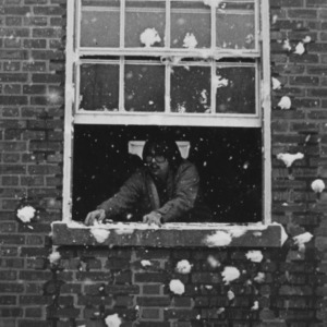 Student looking out window at snow