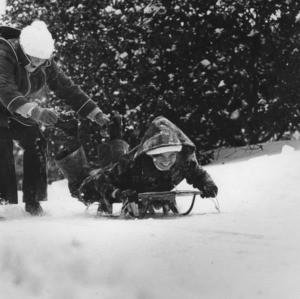 Students sledding in snow
