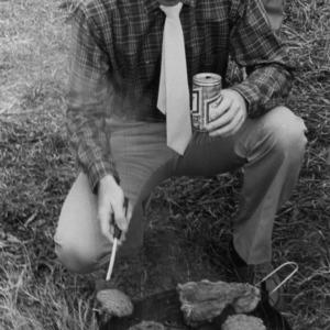 Bob Faires grilling burgers at game