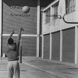Students shooting basketball outside Carmichael Gymnasium