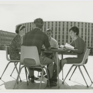 Four students sitting at a table in the Brickyard