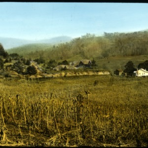 Field and houses in the mountains