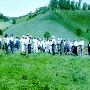 Group of men in a field in the mountains