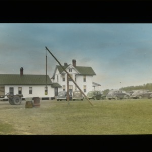 Farm house with cars and well circa 1940