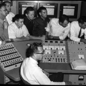 Nuclear Reactor control board with nine people