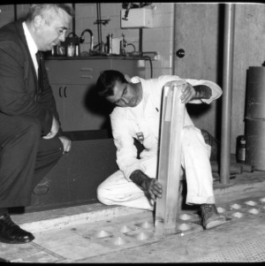 Two men with Nuclear Reactor parts