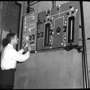 Man at Nuclear Reactor control board