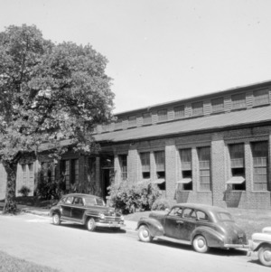 Shop building with cars
