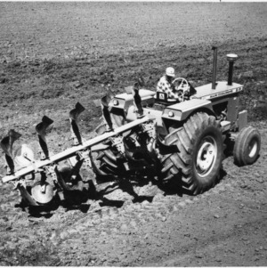 Allis-Chalmers Series 800 Plow pulled by Allis-Chalmers D21 Tractor