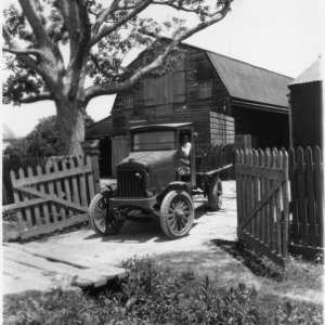 Truck in front of barn