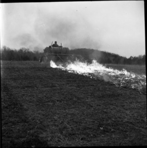 Agricultural machinery and fire in field