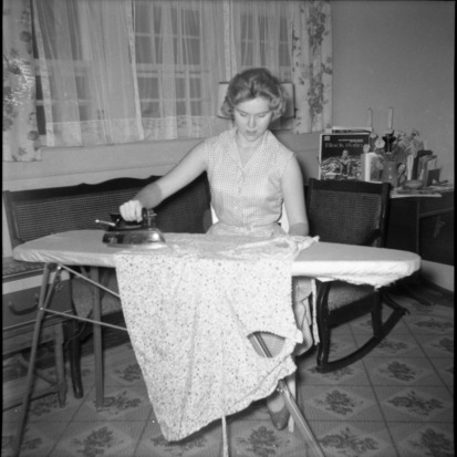 Woman ironing at 4-H electric project