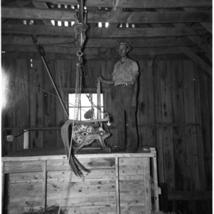 Man using pulley system
