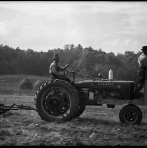 Two men on tractor