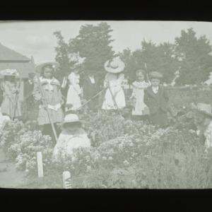 Children tending a garden, circa 1910