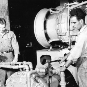 Billy L. Hair and James A. Williams loading water brake into American Locomotive 539