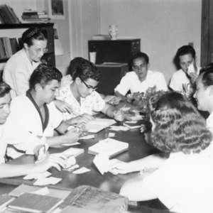 International students playing English class card game