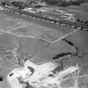 Aerial view of dairy farm before construction of dam