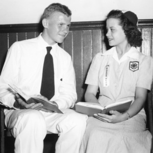 4-H boy and girl with book during 4-H Club Week