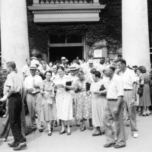 Crowds leaving Pullen Hall during Farm and Home Week