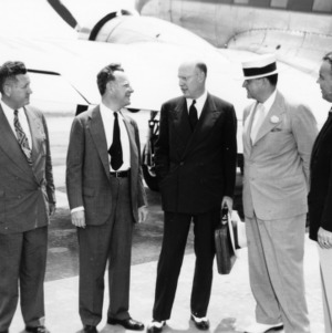 Colonel Harrelson, Jonathan Daniels, US Secretary of Agriculture Charles F. Brannan, Governor W. Kerr Scott, J. Y. Ballentine, Commerce of Agriculture at Airport