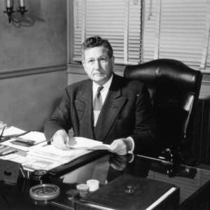 Chancellor John W. Harrelson at desk