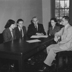 Dr. R. E. Fisher of Cambridge University and others in J. A. Rigney's office