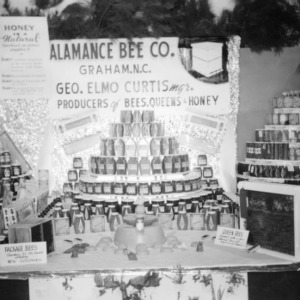 NC State Fair exhibit booth on Alamance Bee Company